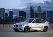 BMW 3 Gran Turismo на фоне большого города