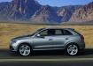 Audi Q3 в движении на фоне пейзажа