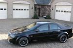 Cadillac BLS - чёрный тюнингованный