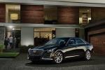 Cadillac CTS - официальное фото автомобиля возле частного дома