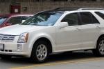 Cadillac SRX - первое поколение в белом цвете